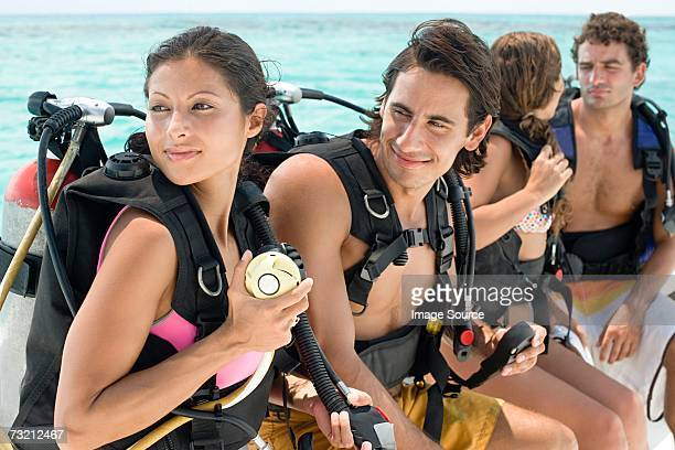 People wearing diving equipment