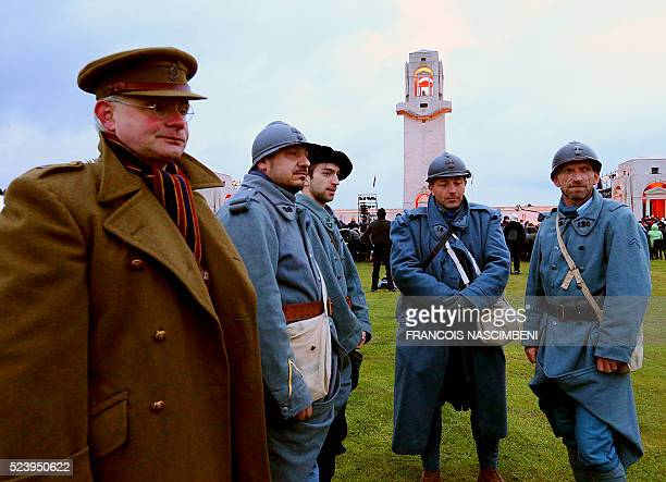 People wearing French and Australian military uniforms of World War I attend the Anzac day in tribute of Australians and New Zealanders soldiers...