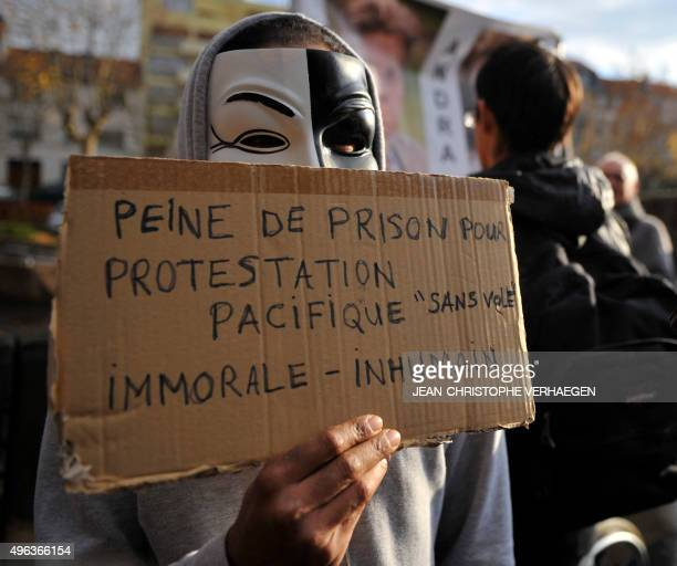 People wearing Guy Fawkes masks demonstrate prior to the trial of three 'Anonymous' for their alleged involvement in cyber attacks targetting...