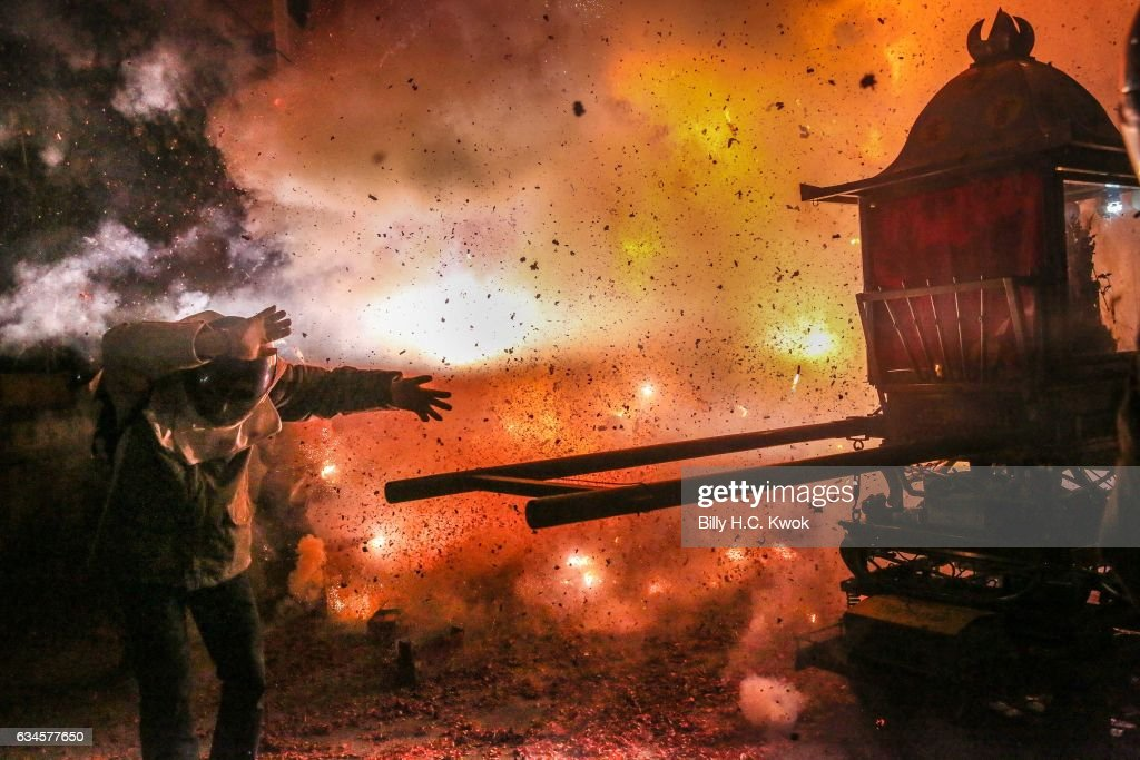 People wearing helmets get sprayed by fire sparks during the Yanshui Beehive Rockets Festival on February 10, 2017 in Yanshui District, Tainan City, Taiwan. The Yanshui Beehive Fireworks Festival is an annual tradition held on the 15th day after the beginning of the Lunar New Year in Tainan Ciy for over 130 years. Located in Yanshui District, it's ranked as the fifth most dangerous festival in the world as participants are geared up with motorcycle helmets, fire-retardant clothing and thick gloves, with hundreds of thousands of firecrackers going off at the same time. According to Taiwan's Tourism Bureau, the 'beehive fireworks' festival started in the late 1885 as a request to the gods to spare Yanshui from a cholera outbreak which was making its way through the villages. Future generations followed this tradition as this year 40 Beehive firecrackers are placed around the city, each firing 600,000 shots, as the Taiwanese believe the 'baptism of fireworks' gets rid of calamity and troubles while bringing good fortune in the new year.