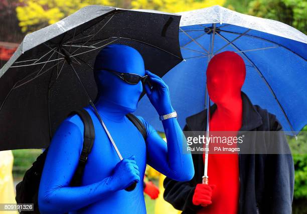 People wearing morphsuits at Drayton Manor Park Staffordshire during a failed attempt to beat the current Guinness World Record for the most people...