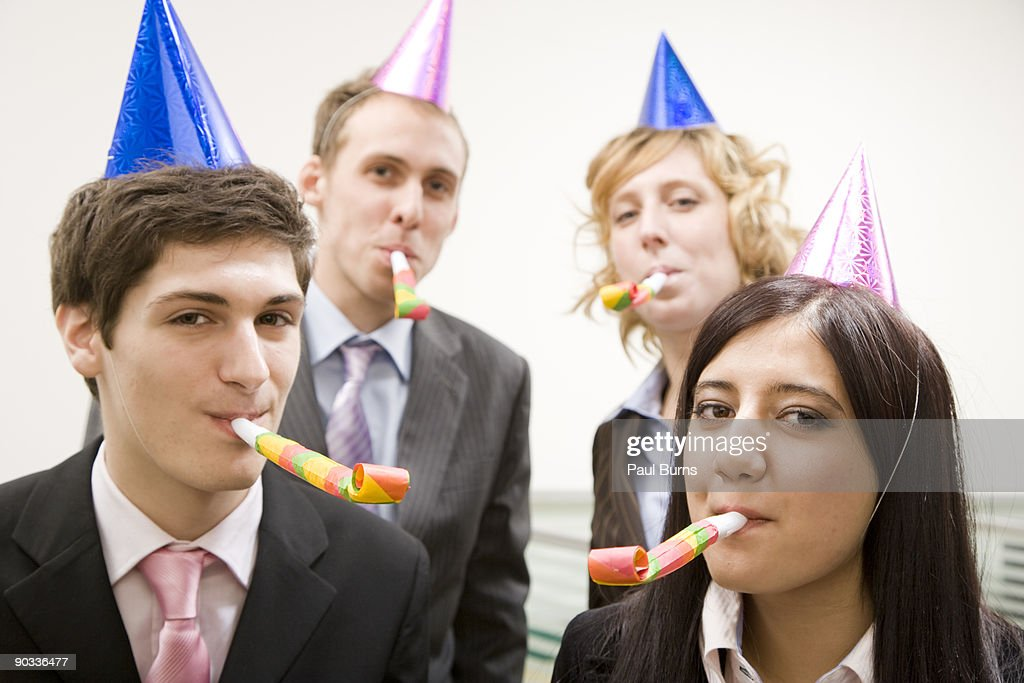 People Wearing Party Hats in Office : Stock Photo