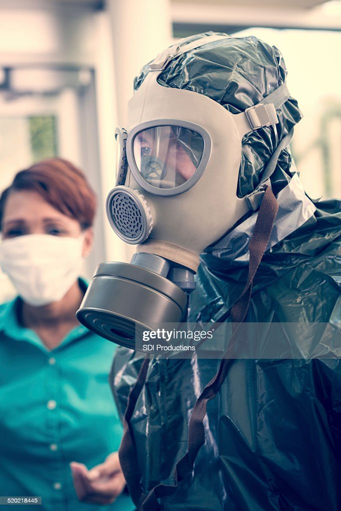 People wearing protective suits and masks during contagious outbreak