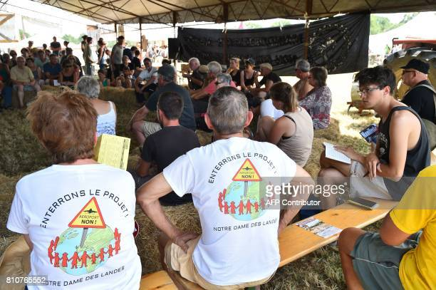 People wearing shirts reading 'bury the project of our airport Notre Dame Des Landes' at a forum during a twoday meeting organised by opponents to a...