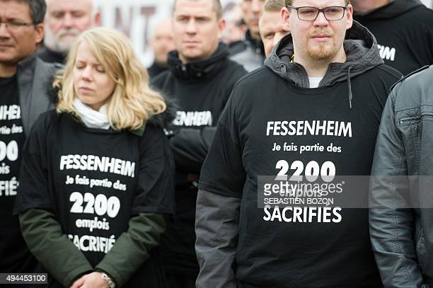 People wearing teeshirt reading 'Fessenheim I'm part of the 2200 sacrified jobs' demonstrate on October 27 in front of the nuclear powerplant of...