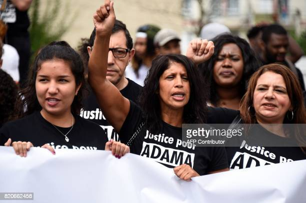 People wearing teeshirts reading 'Justice for Adama' take part in a march in memory of Adama Traore who died during his arrest by the police in July...