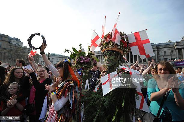 People wearing the St George flag out in London UK celebrating St George's Day Saint George's Day is the feast day of Saint George It is celebrated...