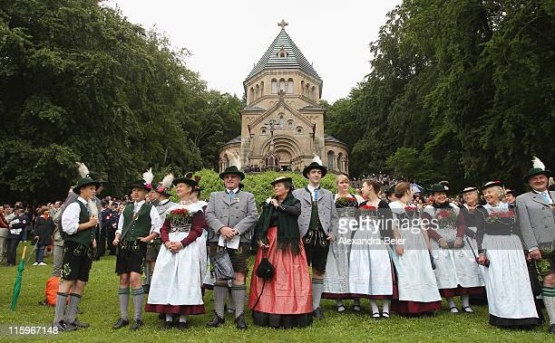 People wearing traditional Bavarian costumes attend a religious mass to be held in honour of the 125th anniversary of the death of Bavarian King...