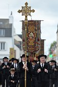 People wearing traditional costumes take part in the 'Grand Pardon' Catholic religious procession on July 26 2016 in SainteAnned'Auray western France...