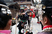 People wearing traditional dress take part in a Taiguanren Festival to pray for blessings in the New Year on February 15 2016 in Qiendongnan Miao and...