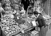 people weekly market market stall with fruit and vegetables salesman marketer aged 40 to 50 years Italy Lombardy Milan