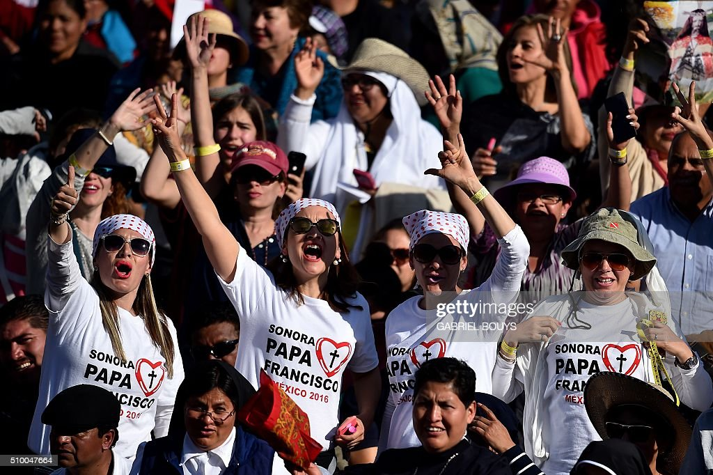 People welcome Pope Francis as he arrives to celebrate a Holy Mass at the Basilica of Our Lady of Guadalupe in Mexico City on February 13, 2016. Pope Francis is in Mexico for a trip encompassing two of the defining themes of his papacy: bridge-building diplomacy and his concern for migrants seeking a better life. AFP PHOTO / GABRIEL BOUYS / AFP / GABRIEL BOUYS