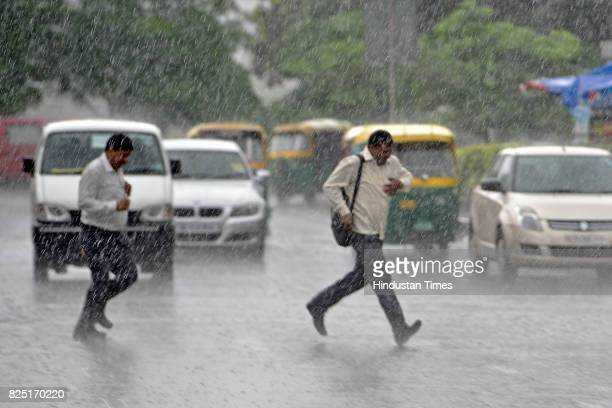 People were caught in the Monsoon rain at Connaught Place on July 31 2017 in New Delhi India Delhites woke up to a drenched morning as rains hit the...
