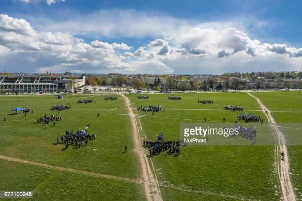 People who attend European Manifest demonstration form twelve UE stars at Blonia meadow in Krakow Poland on 23 April 2017 The proEU and...