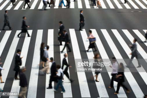 People who cross a pedestrian crossing : Stock Photo