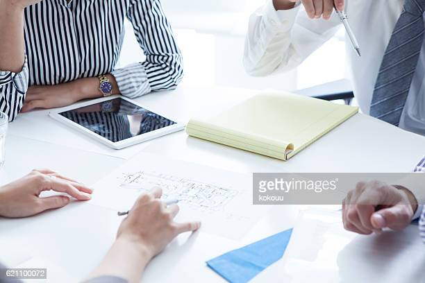 People who have a meeting while looking at company's data