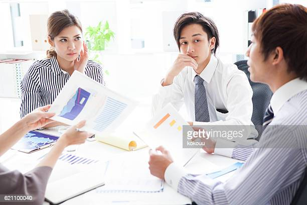People who have a meeting while looking at the graph