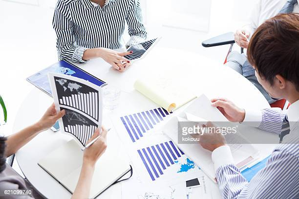 People who have meeting with materials to reference modern office
