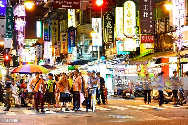 people who shopping in Wanhua District at night