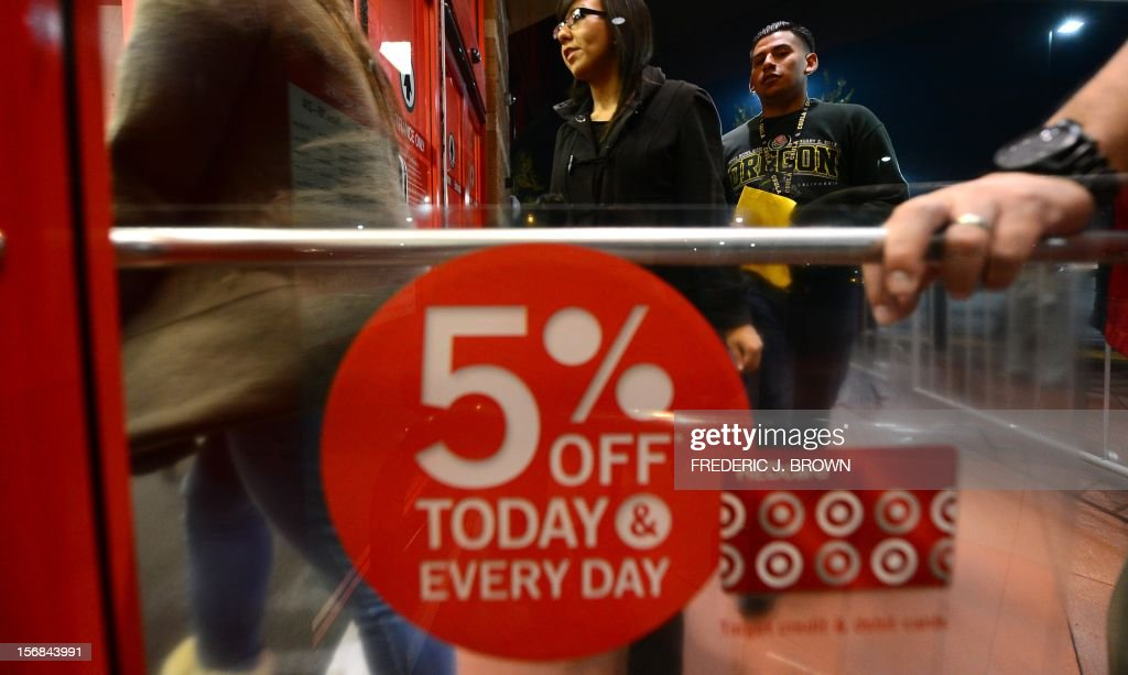 People who waited in line to get an early start on Black Friday shopping deals enter a Target store on November 22, 2012 in Rosemead, California, as many retailers stayed opened during the Thanksgiving celebrations, evidence that even this cherished American family holiday is falling prey to the forces of commerce. AFP PHOTO / Frederic J. BROWN