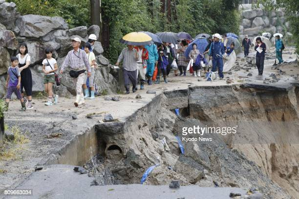 People who were left stranded at an elementary school in Asakura Fukuoka Prefecture hit hard by nearby flooded rivers evacuate on July 6 2017 Search...