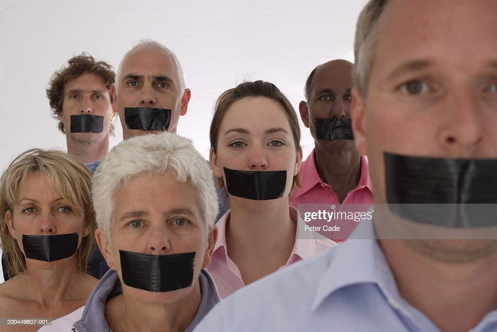 People with black tape over mouths, portrait : Stock Photo