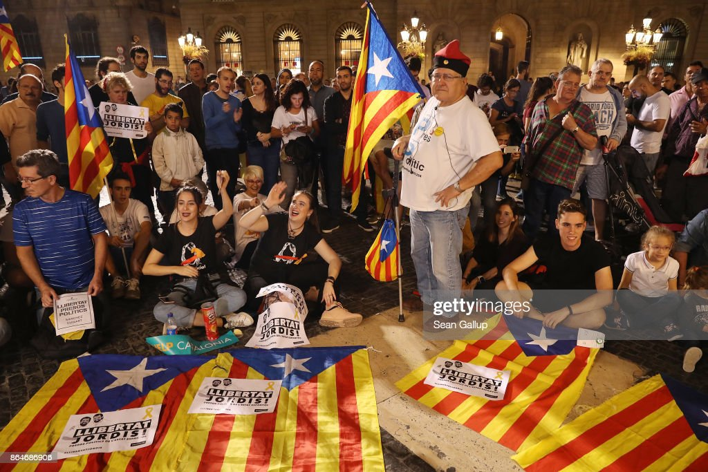 People with Catalan independence flags gather in front of the Palau de la Generalitat de Catalunya, the building that houses the Catalonian presidency, following a demonstration for Catalan independence to demand the release of imprisoned Catalan leaders Jordi Sanchez and Jordi Cuixart on October 21, 2017 in Barcelona, Spain. The Spanish government announced measures today it will implement in triggering Article 155, which would lead to the imposition of direct rule by Spanish authorities in Catalonia and at least temporarily suspend the region's autonomy. The government also plans to hold Catalan regional elections in January. The moves come after Catalan regional President Carles Puigdemont let a Thursday deadline today pass and threatened to go forward with Catalan independence.