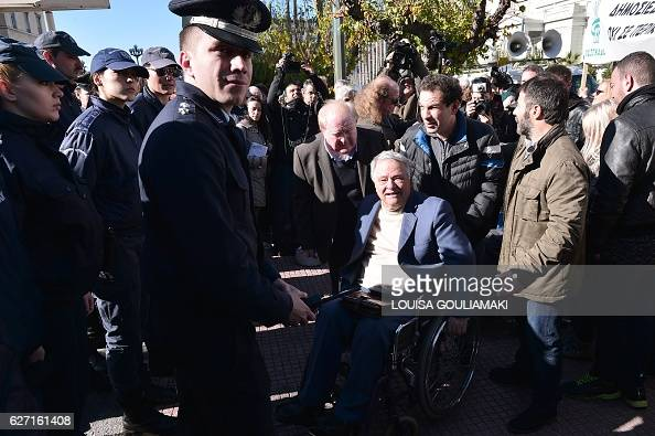 People with disabilities face police officers as they take part in an antiausterity rally in front of the greek parliament in central Athens on...