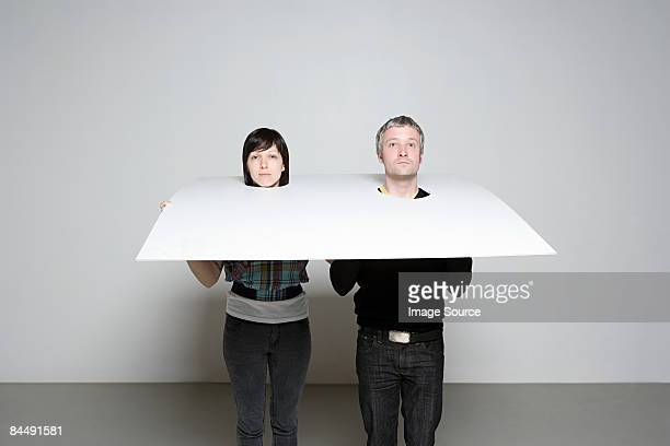People with heads in board