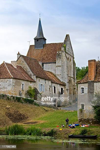 People with kayaks in traditional medieval village of Angles Sur L'Anglin Vienne near Poitiers France