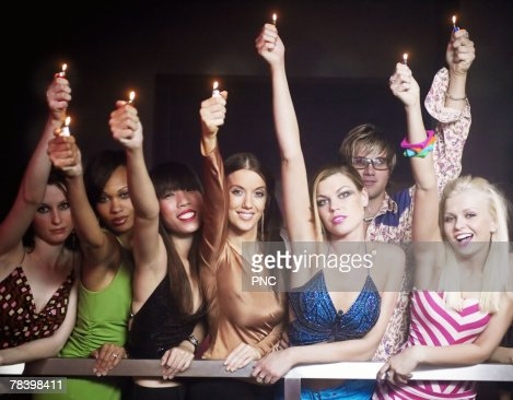 People with lighters at a concert : Stock Photo
