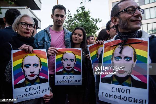 People with placards with face of Vladimir Putin during a protest against homosexual extermination in Chechnya in front of the Russian Embassy