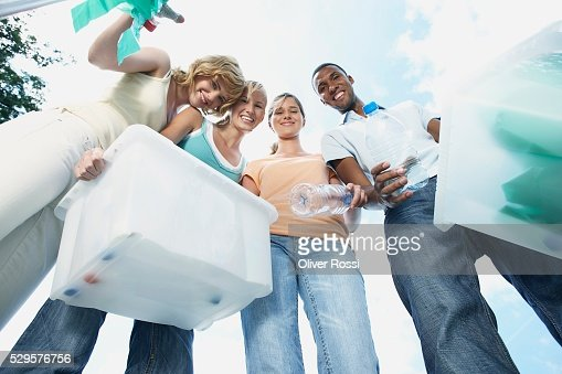 People with Recycling Bins : Stock Photo