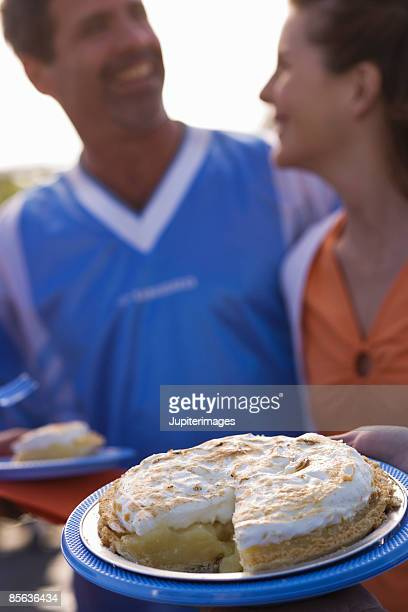 People with sliced lemon meringue pie