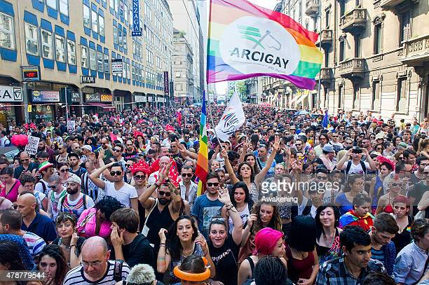 People with slogans and flags march during the Gay Pride parade on June 27 2015 in Milan Italy Yesterday the United States Supreme Court legalized...
