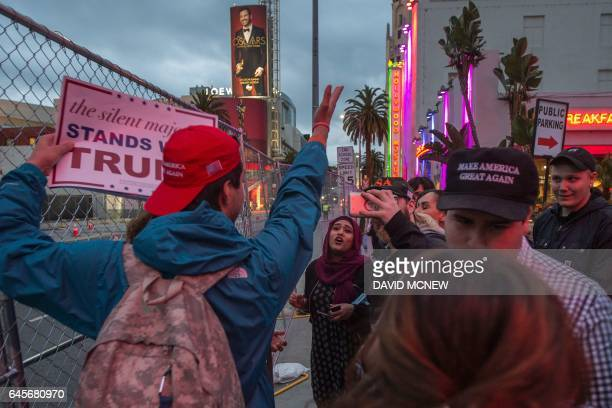 TOPSHOT People with the San Fernando Valley For Trump Celebration Group argue with a woman passing by near the site of the 89th Academy Awards...