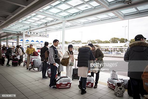 People with their dogs wait rented cars at the airport in Kagoshima Japan on January 27 2017 Japan Airlines 'wan wan jet tour' allows owners and...