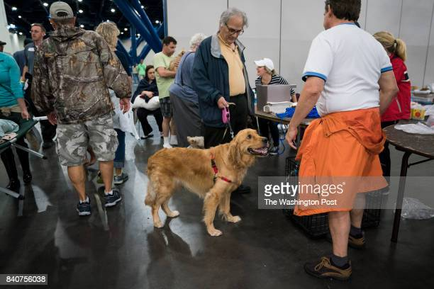 People with their pets seek shelter at the George R Brown Convention Center in Houston TX on Monday Aug 28 2017 Rising water from Hurricane now...