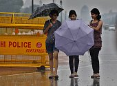 People with their umbrellas during heavy rain at Rajpath on August 25 2013 in New Delhi India Many parts of Delhi/Noida experienced heavy rains in...