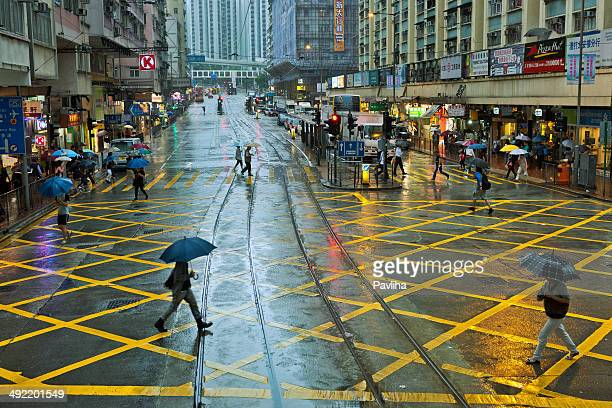 People with Umbrellas on Streets of Hong Kong, China, Asia