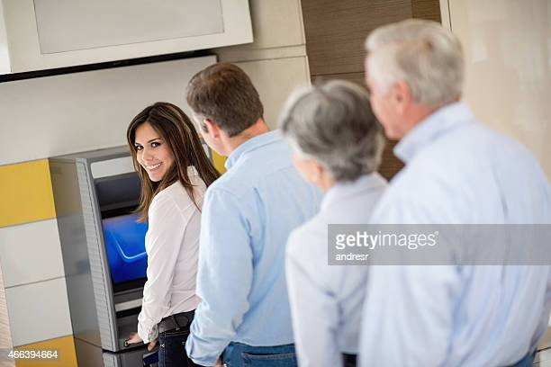 People withdrawing cash from an ATM