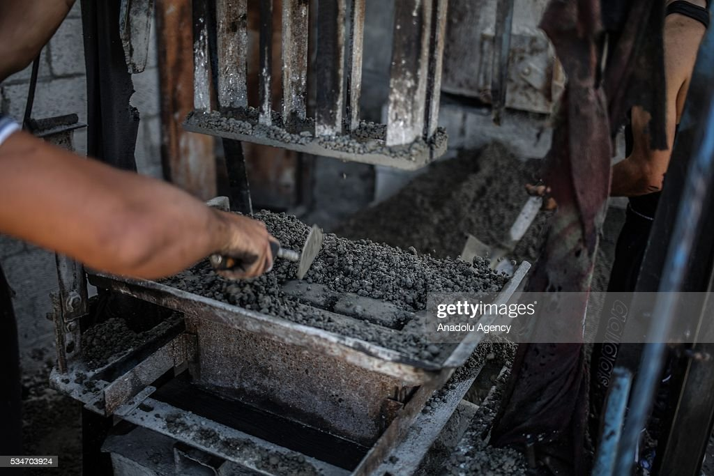 People work at a concrete brick factory, restarting to manufacture after Israel allowed building materials' passing from Karim Abu Salim border gate in Gaza City, Gaza on May 25, 2016.