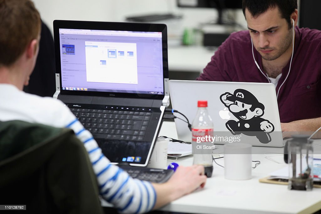 People work at computers in TechHub, an office space for technology start-up entrepreneurs, near the Old Street roundabout in Shoreditch which has been dubbed 'Silicon Roundabout' due to the number of technology companies operating from the area on March 15, 2011 in London, England. Entrepreneurs using TechHub are predominantly product-oriented tech companies who rent desk space and use the fast wifi. The relatively low rental rates and proximity to media and internet companies has made the area close to the roundabout a prime location for IT firms and web entrepreneurs.
