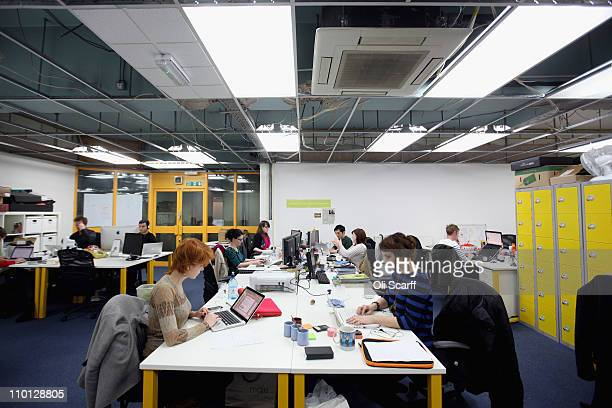 People work at computers in TechHub an office space for technology startup entrepreneurs near the Old Street roundabout in Shoreditch which has been...