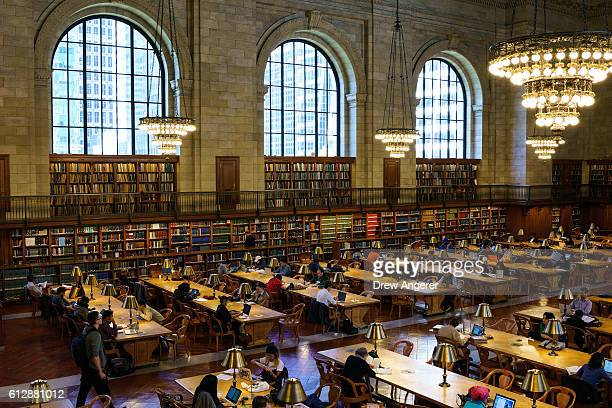 People work at desks in the Rose Main Reading Room at the New York Public Library October 5 2016 in New York City The Rose Main Reading Room has been...