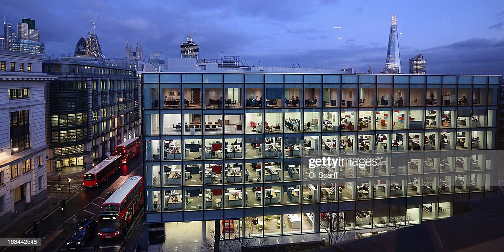 People work at dusk on various floors of the modern office development at 20 Cannon Street near St Paul's Cathedral on February 06, 2013 in London, England. A recent study of European working hours has shown that British men have the longest working week of any European Union country.