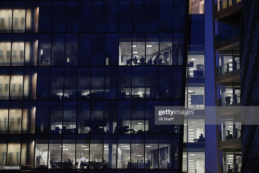 People work at dusk on various floors of the modern office development in Paddington on February 08, 2013 in London, England. A recent study of European working hours has shown that British men have the longest working week of any European Union country.