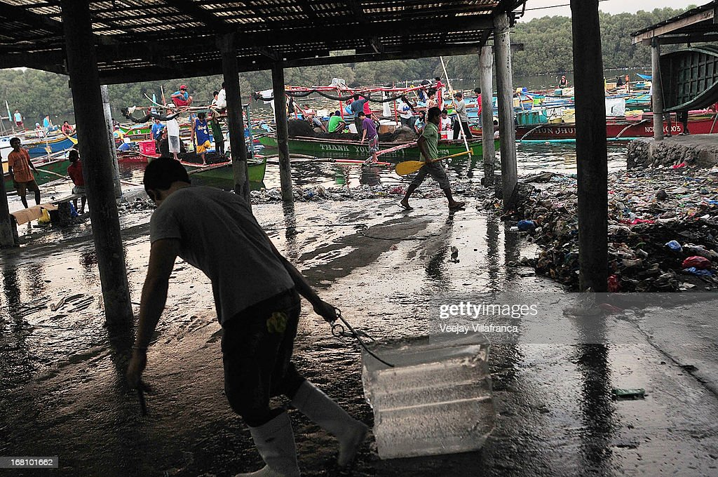 People work at the wet market near Freedom Island on May 5, 2013 in Manila, Philippines. Around 13,000 hectares of the coastal area is to be recalimed and developed under the Public Private Partnership (PPP) of the Philippine government.