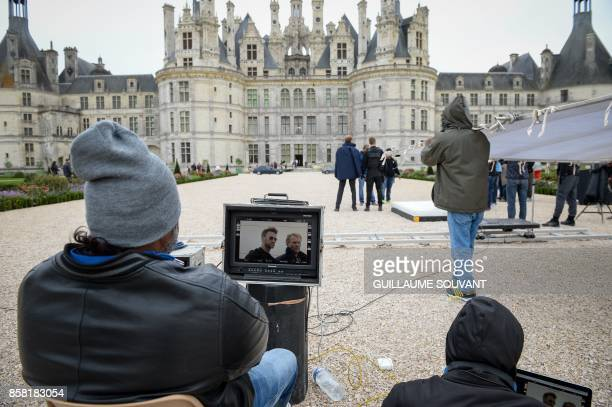 People work during the shooting of the Indian action film 'Junga' at the Chateau of Chambord on October 5 2017 The film in Tamil features Vijay...