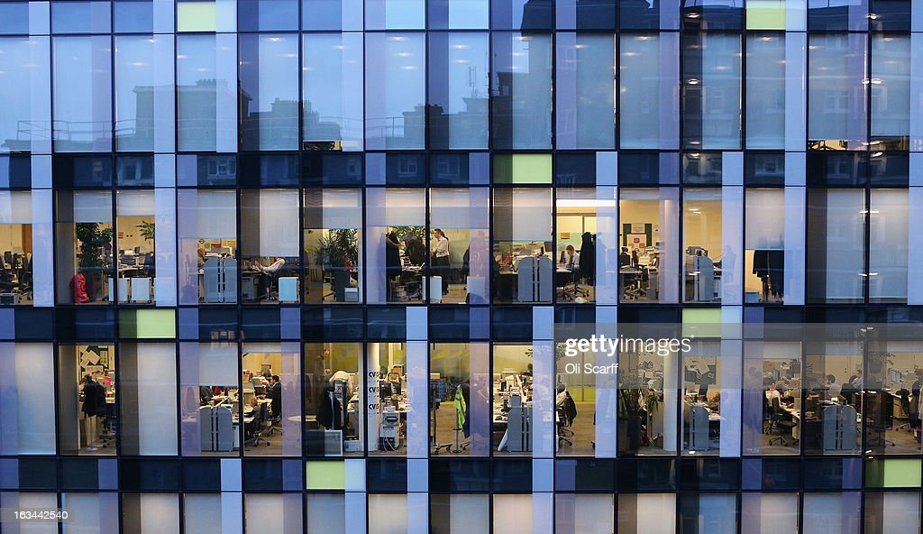 People work in the offices of the Palestra tower, which houses the administration of 'Transport for London,' at dusk on January 28, 2013 in London, England. A recent study of European working hours has shown that British men have the longest working week of any European Union country.